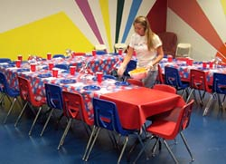 girl setting up a party room